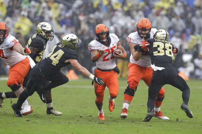 Illinois running back Dre Brown (25) is tackled by Purdue linebacker Ben Holt (44) during the first half of an NCAA college football game, Saturday, Oct. 26, 2019, in West Lafayette, Ind. (AP Photo/Darron Cummings)