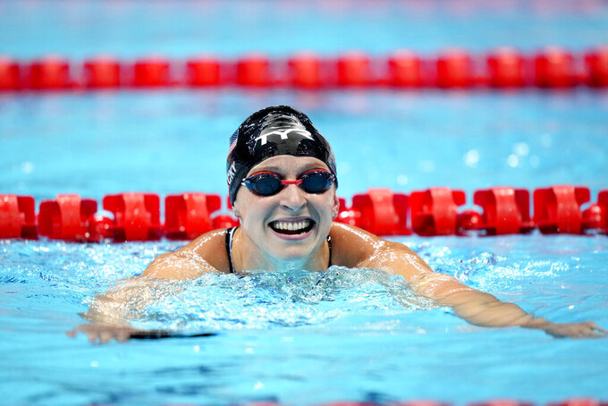 Kathleen Ledecky, of the United States, leaves the pool after winning the women's 800-meter freestyle final at the 2020 Summer Olympics, Saturday, July 31, 2021, in Tokyo, Japan. (AP Photo/David Goldman)