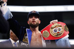 Caleb Plant holds his IBF super middleweight championship belt after defeating Vincent Feigenbutz, of Germany, in a boxing match Saturday, Feb. 15, 2020, in Nashville, Tenn. (AP Photo/Mark Humphrey)