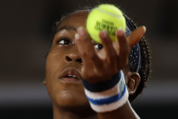 Cori Gauff of the U.S. serves against Italy's Martina Trevisan in the second round match of the French Open tennis tournament at the Roland Garros stadium in Paris, France, Wednesday, Sept. 30, 2020. (AP Photo/Alessandra Tarantino)