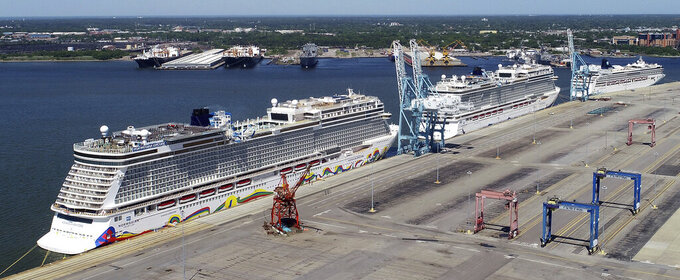 FILE - In this May 4, 2020 file photo, Norwegian cruise ships are docked at Portsmouth Marine Terminal in Portsmouth, Va. Norwegian Cruise Line is announcing plans to resume sailing after being shut down for more than a year by the pandemic. Norwegian said Tuesday, May 4, 2020,  that it plans trips in late July in the Greek islands and in August in the Caribbean.  (Stephen M. Katz/The Virginian-Pilot via AP, File)