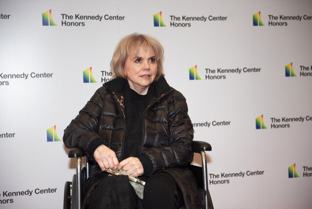 2019 Kennedy Center Honoree singer Linda Ronstadt arrives at the State Department for the Kennedy Center Honors State Department Dinner on Saturday, Dec. 7, 2019, in Washington. (AP Photo/Kevin Wolf)