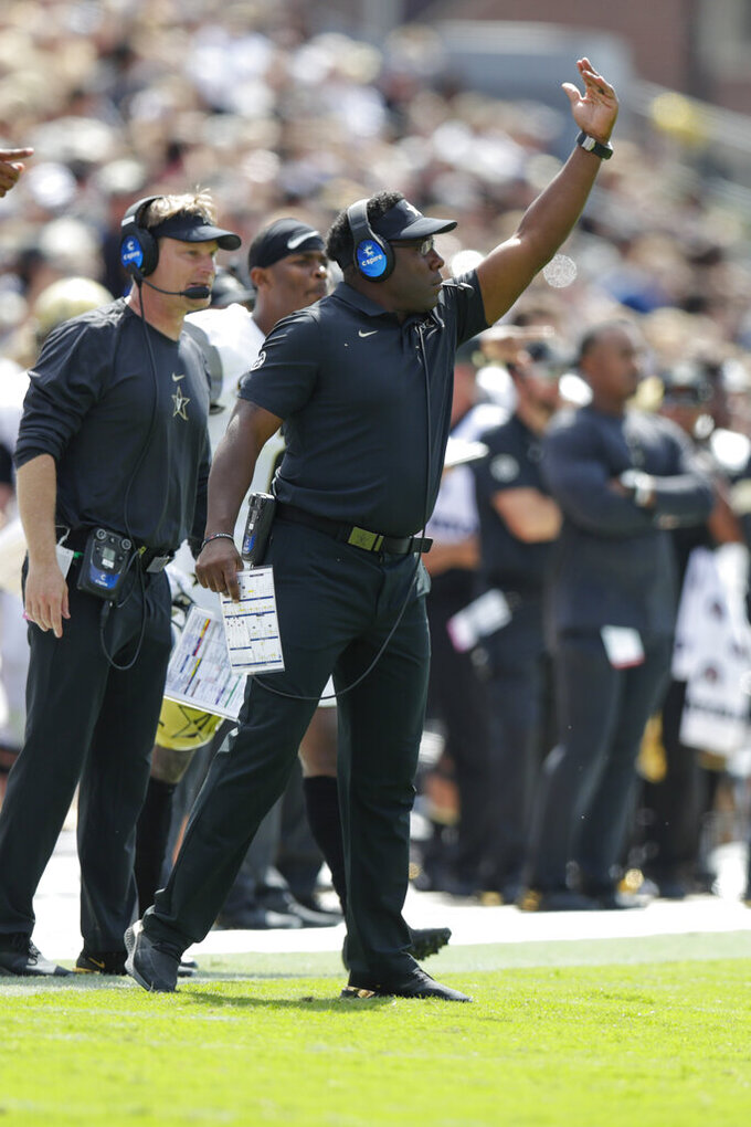 Vanderbilt head coach Derek Mason signals from the sidelines during the first half of an NCAA college football game against Purdue in West Lafayette, Ind., Saturday, Sept. 7, 2019. (AP Photo/Michael Conroy)
