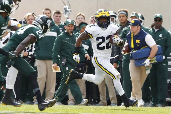 Michigan running back Karan Higdon breaks downfield during the first half of an NCAA college football game against Michigan State , Saturday, Oct. 20, 2018, in East Lansing, Mich. (AP Photo/Carlos Osorio)