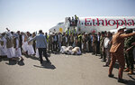 Yemeni prisoners pray during their arrival after being released by the Saudi-led coalition at the airport in Sanaa, Yemen, Thursday, Oct. 15, 2020. (AP Photo/Hani Mohammed)