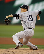 New York Yankees pitcher Masahiro Tanaka works against the Oakland Athletics in the first inning of a baseball game Thursday, Aug. 22, 2019, in Oakland, Calif. (AP Photo/Ben Margot)