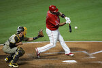 Los Angeles Angels' Albert Pujols hits a double during the fourth inning of a baseball game against the San Diego Padres, Wednesday, Sept. 2, 2020, in Anaheim, Calif. (AP Photo/Jae C. Hong)