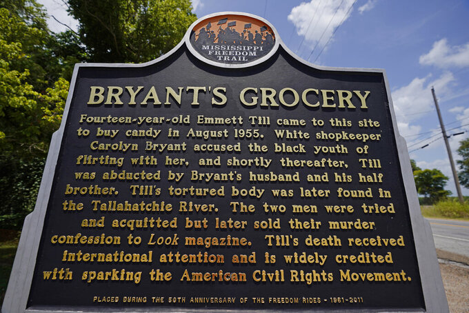 A Mississippi Freedom Trail marker sits before the remains of Bryant's Grocery and Meat Market in Money, Miss., July 14, 2021, where in 1955, Emmett Till, a 14-year-old African American teen, was accused of whistling at a white woman, at the family's store. Till was later kidnapped, beaten and killed. For more than a century, one of Mississippi's largest and most elaborate Confederate monuments has looked out over the lawn at the courthouse in the center of Greenwood. It's a Black-majority city with a rich civil rights history. Officials voted last year to remove the statue, but little progress has been made to that end. (AP Photo/Rogelio V. Solis)
