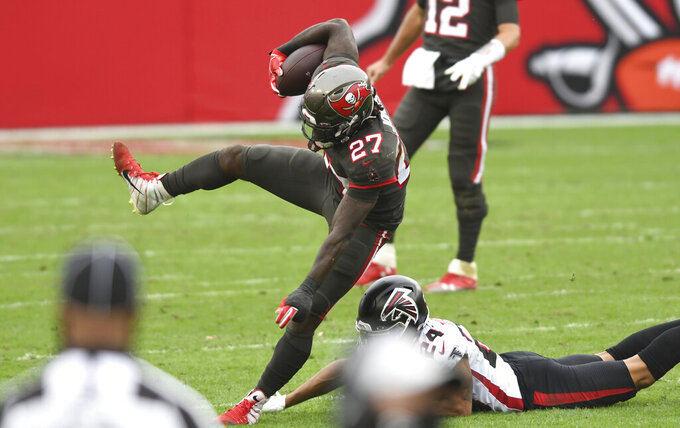 Tampa Bay Buccaneers running back Ronald Jones II (27) eludes Atlanta Falcons cornerback A.J. Terrell (24) during the second half of an NFL football game Sunday, Jan. 3, 2021, in Tampa, Fla. (AP Photo/Jason Behnken)