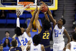 UCLA guard Kris Wilkes, right, blocks a shot from California forward Andre Kelly (22) during the second half of an NCAA college basketball game Saturday, Jan. 5, 2019, in Los Angeles. (AP Photo/Marcio Jose Sanchez)