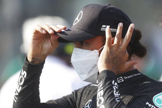 Mercedes driver Lewis Hamilton of Britain gestures after the Sprint qualifying at the Monza racetrack, in Monza, Italy , Saturday, Sept.11, 2021. The Formula one race will be held on Sunday. (Lars Baron/Pool photo via AP)