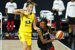 Las Vegas Aces guard Danielle Robinson (3) drives around Seattle Storm forward Breanna Stewart (30) during the first half of Game 3 of basketball's WNBA Finals Tuesday, Oct. 6, 2020, in Bradenton, Fla. (AP Photo/Chris O'Meara)