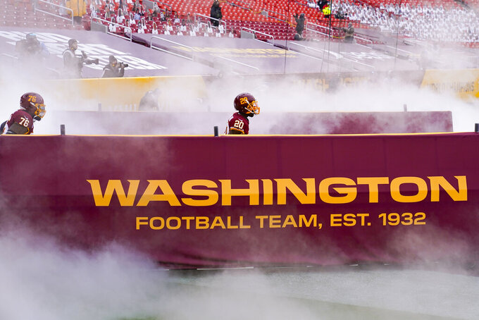 Washington Football Team offensive tackle Morgan Moses (76) cornerback Jimmy Moreland (20) taking the field to begin the first half of an NFL football game against the Seattle Seahawks, Sunday, Dec. 20, 2020, in Landover, Md. (AP Photo/Susan Walsh)