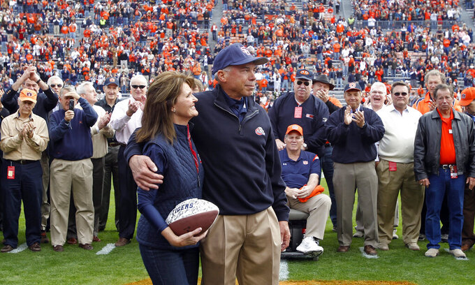FILE - In this Saturday, Nov. 19, 2011, file photo, Samford coach Pat Sullivan is recognized with wife Jean on the 40th anniversary of his winning the Heisman trophy as quarterback at Auburn, before an NCAA college football game between Samford and Auburn, in Auburn, Ala. Sullivan, the 1971 Heisman Trophy winner at Auburn who went on to coach TCU and Samford, died Sunday, Dec. 1, 2019. He was 69. (AP Photo/Butch Dill, File)