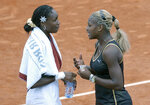 FILE - In this June 8, 2002, file photo, Serena Williams, right, talks with her sister Venus after Serena won the women's final of the French Open tennis tournament at Roland Garros stadium in Paris. Serena Williams defeated her sister Venus 7-5, 6-3. Serena entered this match with one Grand Slam singles title; she now owns a professional-era record 23. This also began a Sister Slam streak in which Serena beat her older sibling in four consecutive all-in-the-family major finals. Two days after the finale in Paris, they would move atop the rankings together, with Venus at No. 1, and Serena No. 2 -- two people from one household at 1-2 for the only time in tennis history. (AP Photo/Christophe Ena, File)