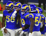 Los Angeles Rams linebacker Justin Hollins (58) reacts after stopping the New England Patriots on fourth down in the first half of an NFL football game in Inglewood, Calif., Thursday, Dec. 10, 2020. (Keith Birmingham/The Orange County Register via AP)