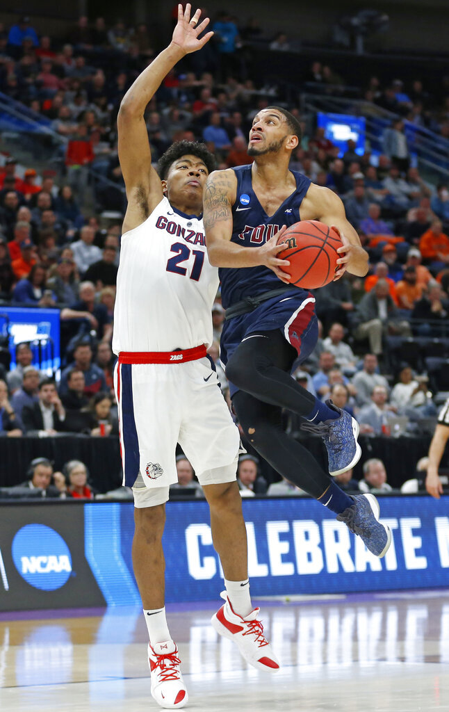 Fairleigh Dickinson guard Darnell Edge, right, drives to the basket as Gonzaga forward Rui Hachimura (21) defends in the first half of a first-round game in the NCAA men's college basketball tournament Thursday, March 21, 2019, in Salt Lake City. (AP Photo/Rick Bowmer)