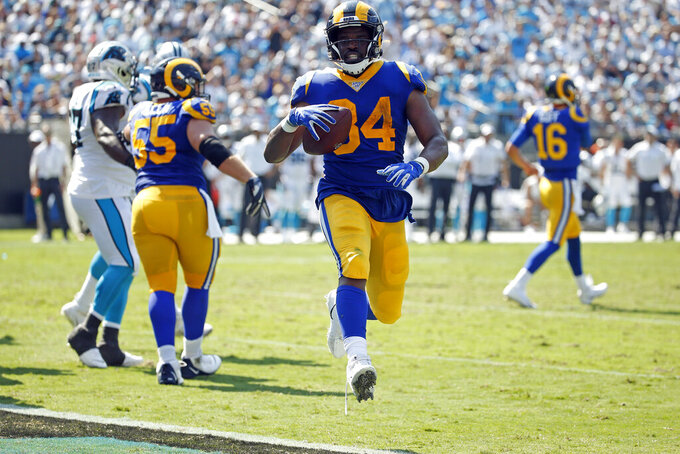 Los Angeles Rams running back Malcolm Brown (34) runs into the end zone for a touchdown during the second half of an NFL football game against the Carolina Panthers in Charlotte, N.C., Sunday, Sept. 8, 2019. (AP Photo/Brian Blanco)