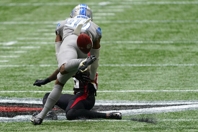 Atlanta Falcons wide receiver Calvin Ridley (18) and Detroit Lions cornerback Jeff Okudah (30) vie for a passed ball during the first half of an NFL football game, Sunday, Oct. 25, 2020, in Atlanta. (AP Photo/John Bazemore)