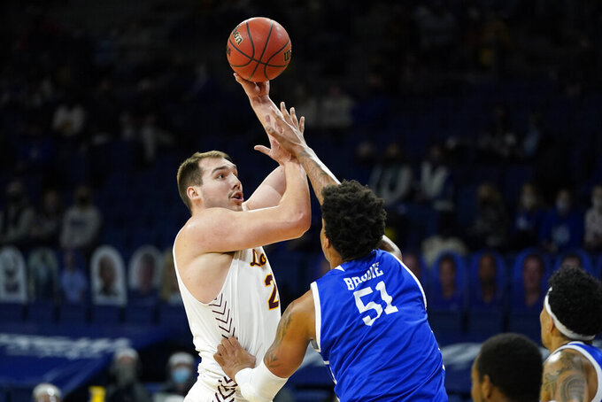 Loyola of Chicago center Cameron Krutwig shoots over Drake forward Darnell Brodie, right, during the first half of an NCAA college basketball game, Sunday, Feb. 14, 2021, in Des Moines, Iowa. (AP Photo/Charlie Neibergall)
