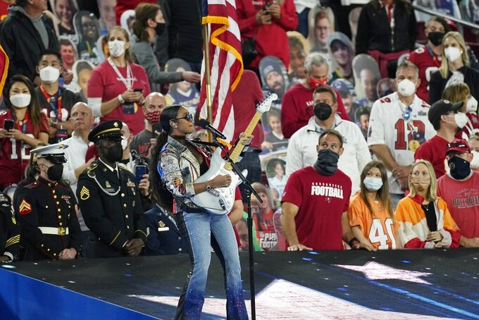 "H.E.R. performs ""America the Beautiful"" before the NFL Super Bowl 55 football game between the Kansas City Chiefs and Tampa Bay Buccaneers, Sunday, Feb. 7, 2021, in Tampa, Fla. (AP Photo/David J. Phillip)"