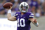 Kansas State quarterback Skylar Thompson (10) passes to a teammate during the first half of an NCAA college football game against West Virginia in Manhattan, Kan., Saturday, Nov. 16, 2019. (AP Photo/Orlin Wagner)