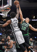 San Antonio Spurs' DeMar DeRozan (10) is fouled by Boston Celtics' Grant Williams during the first half of an NBA basketball game, Saturday, Nov. 9, 2019, in San Antonio. (AP Photo/Darren Abate)
