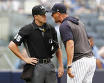 New York Yankees' Aaron Boone, right, gets in the face of home plate umpire Brennan Miller during the second inning of game one of a baseball doubleheader against the Tampa Bay Rays, Tuesday, July 16, 2019, in New York. Boone had already been ejected when he expressed his displeasure with the umpire's calls. (AP Photo/Kathy Willens)