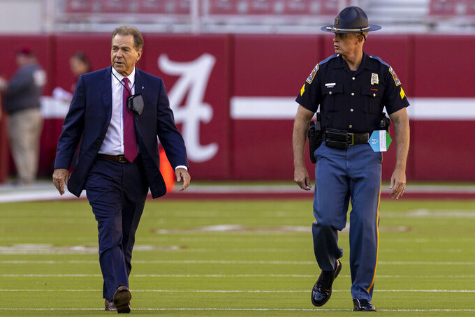 Alabama head coach Nick Saban walks the field after his arrival before an NCAA college football game against Southern Miss, Saturday, Sept. 25, 2021, in Tuscaloosa, Ala. (AP Photo/Vasha Hunt)