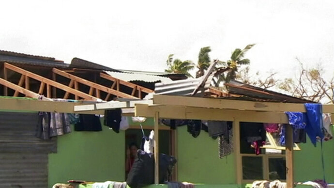 This image made from a video, shows a house damaged by Cyclone Gita in Nuku'alofa, Tonga Wednesday, Feb. 14, 2018. Thousands of Tonga residents face a long wait for power and other services to be restored after a cyclone tore through the Pacific nation this week. (TVNZ via AP)