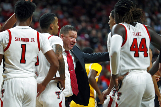 Texas Tech coach Chris Beard talks to his players in a timeout during the second half of an NCAA college basketball game against Southern Mississippi, Monday, Dec. 16, 2019, in Lubbock, Texas. (Brad Tollefson/Lubbock Avalanche-Journal via AP)