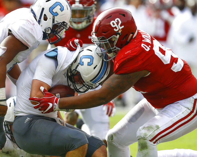 FILE - In this Nov. 17, 2018, file photo, Citadel quarterback Brandon Rainey (16) is stopped by Alabama defensive lineman Quinnen Williams (92) as he tries to carry the ball during the second half of an NCAA college football game in Tuscaloosa, Ala. Williams is a contender to be the first overall NFL draft pick, held by the Arizona Cardinals. (AP Photo/Butch Dill, File)