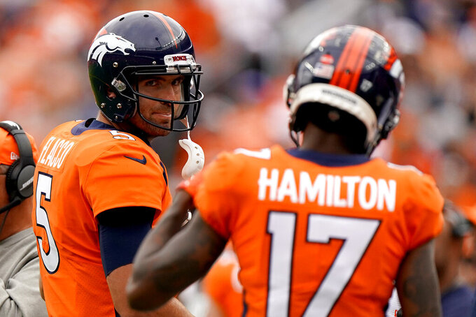 Denver Broncos quarterback Joe Flacco (5) looks at wide receiver DaeSean Hamilton (17) as they walk to the bench after throwing an interception against the Chicago Bears during the second half of an NFL football game, Sunday, Sept. 15, 2019, in Denver. (AP Photo/Jack Dempsey)