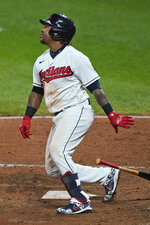Cleveland Indians' Jose Ramirez watches his two-run double during the seventh inning of the team's baseball game against the Chicago White Sox, Thursday, Sept. 24, 2020, in Cleveland. (AP Photo/Tony Dejak)