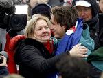 Bronze medal winner ScottyJames, of Australia, hugs his mom, Celia, after the men's halfpipe finals at Phoenix Snow Park at the 2018 Winter Olympics in Pyeongchang, South Korea, Wednesday, Feb. 14, 2018. (AP Photo/Gregory Bull)