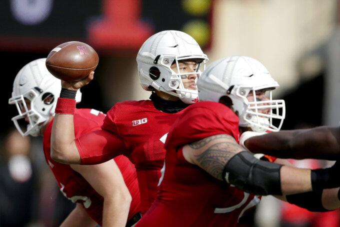 Nebraska quarterback Adrian Martinez (2) throws a pass during the first half of an NCAA college football game against Illinois in Lincoln, Neb., Saturday, Nov. 10, 2018. (AP Photo/Nati Harnik)