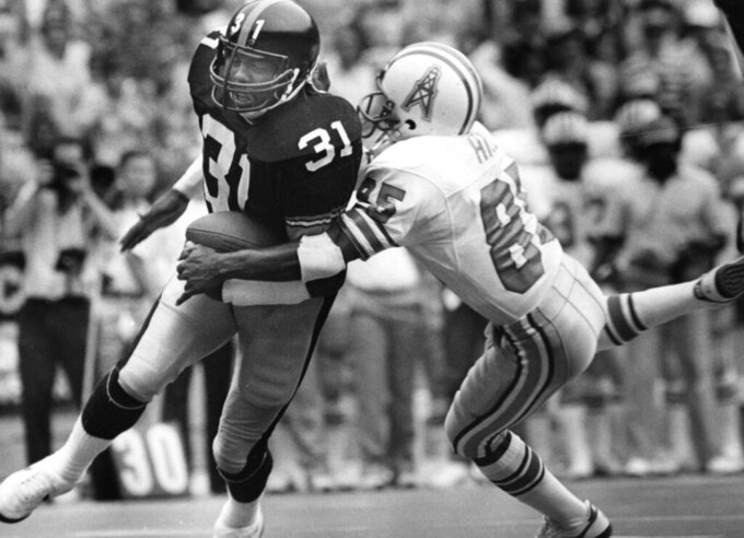 In this Sept. 22, 1985, photo, Pittsburgh Steelers strong safety Donnie Shell returns an interception against Houston Oilers receiver Drew Hill during an NFL football game at Three Rivers Stadium in Pittsburgh. Donnie Shell knew he was ahead of his time. It's why the Pittsburgh Steelers safety never worried about whether he'd get into the Hall of Fame. His long wait ended this week, when he got the call more than 30 years after playing his final game.(Pittsburgh Post-Gazette via AP)
