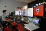 In this photo taken Tuesday, Aug. 27, 2019, Zach Gerhart, assistant director of broadcasting and video production, works in the ACC Network broadcast facility at North Carolina State in Raleigh, N.C. The Atlantic Coast Conference finally has its TV channel airing hundreds of league sporting events each year thanks in no small measure to its schools. Administrations around the ACC played a critical role in getting the channel up and running, spending millions to ensure campus broadcast and production facilities were capable of handling telecasts.  (AP Photo/Gerry Broome)
