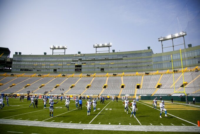 The Detroit Lions warm up before an NFL football game against the Green Bay Packers Sunday, Sept. 20, 2020, in Green Bay, Wis. (AP Photo/Matt Ludtke)