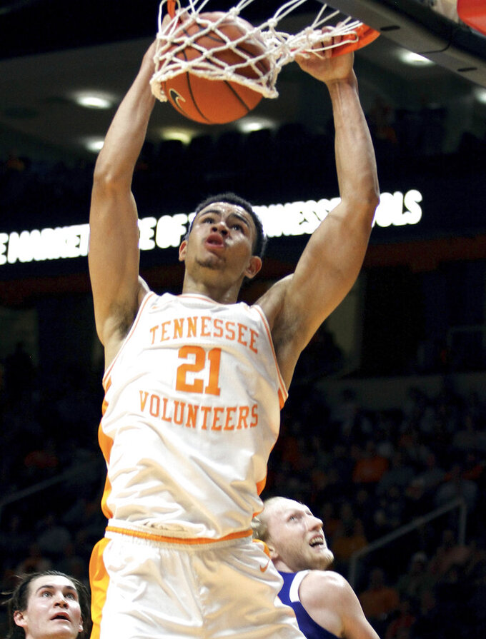 Tennessee's Oliver Nkamhoua (21) dunks the ball against UNC Asheville during an NCAA college basketball game Tuesday, Nov. 5, 2019, in Knoxville, Tenn. (Tom Sherlin/The Daily Times via AP)