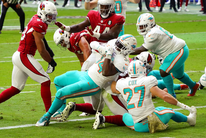 Miami Dolphins running back Jordan Howard, center, scores a touchdown against the Arizona Cardinals during the first half of an NFL football game, Sunday, Nov. 8, 2020, in Glendale, Ariz. (AP Photo/Rick Scuteri)