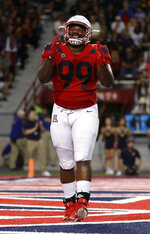 Arizona defensive tackle Dereck Boles smiles after a fourth-down stop during the second half of the team's NCAA college football game against California on Saturday, Oct. 6, 2018, in Tucson, Ariz. (AP Photo/Chris Coduto)
