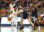 Syracuse forward Elijah Hughes, left, has the ball tipped away by Virginia guard Ty Jerome during the first half of an NCAA college basketball game in Syracuse, N.Y., Monday, March 4, 2019. (AP Photo/Adrian Kraus)