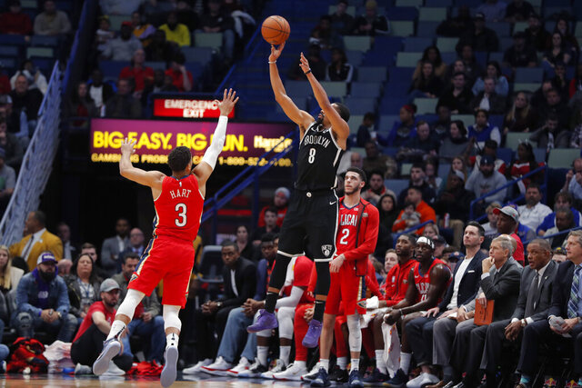 Brooklyn Nets guard Spencer Dinwiddie (8) attempts a 3-point shot against New Orleans Pelicans guard Josh Hart (3) in the first half of an NBA basketball game in New Orleans, Tuesday, Dec. 17, 2019. (AP Photo/Gerald Herbert)