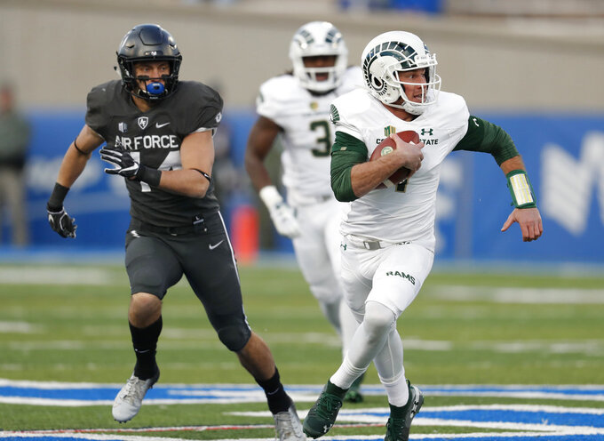 Colorado State quarterback K.J. Carta-Samuels, right, runs for a short gain past Air Force linebacker Parker Noren in the second half of an NCAA college football game Thursday, Nov. 22, 2018, at Air Force Academy, Colo. Air Force won 27-19. (AP Photo/David Zalubowski)