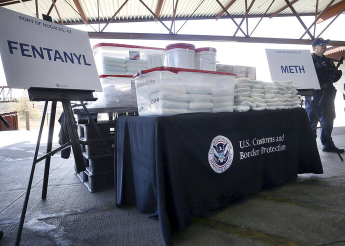 FILE - This Thursday, Jan. 31, 2019 file photo shows a display of the fentanyl and meth that was seized by Customs and Border Protection officers at the Nogales Port of Entry, during a news conference in Nogales, Ariz. According to a report released by the Centers for Disease Control and Prevention on Friday, Oct. 25, 2019, fentanyl is driving drug overdose deaths in the U.S. overall, but in nearly half of the country, it's a different story. Meth is the bigger killer. (Mamta Popat/Arizona Daily Star via AP)