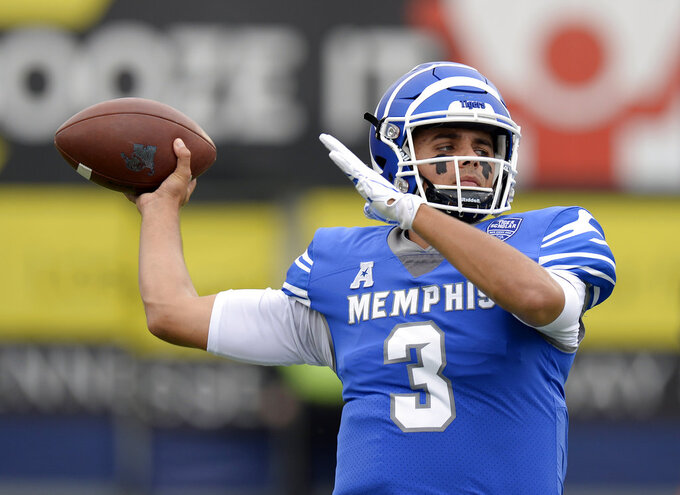 Memphis quarterback Brady White warms up before an NCAA college football game against Central Florida Saturday, Oct. 13, 2018, in Memphis, Tenn. (AP Photo/Mark Zaleski)