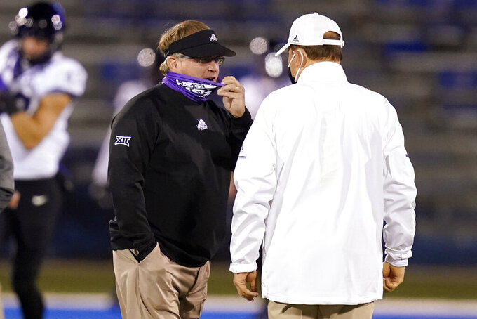 TCU coach Gary Patterson, left, talks with Kansas coach Les Miles before an NCAA college football game in Lawrence, Kan., Saturday, Nov. 28, 2020. (AP Photo/Orlin Wagner)