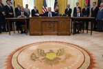 President Donald Trump participates in a signing ceremony with Serbian President Aleksandar Vucic, left, and Kosovar Prime Minister Avdullah Hoti, in the Oval Office of the White House, Friday, Sept. 4, 2020, in Washington. (AP Photo/Evan Vucci)