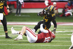 Missouri running back Larry Rountree III is tackled by Arkansas defender Bumper Pool during the second half of an NCAA college football game Friday, Nov. 29, 2019, in Little Rock, Ark. (AP Photo/Michael Woods)